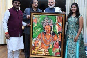 Late Mr M.R Pimpare offering a digital painting from Ajanta Temple to Shri Prime Minister Narendra Modi